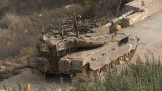 Israel, Circa 2011 - IDF tank driving next to the lebanon border