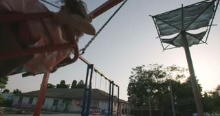 Kids on a big swing enjoying together in the playground