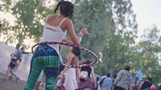 KINERET, ISRAEL, April 6 2018-A girl dancing with a hola hoop in a trance party