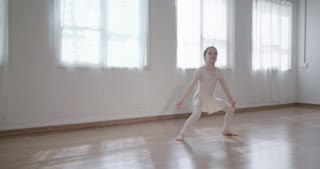 Little girl dancing alone in a studio