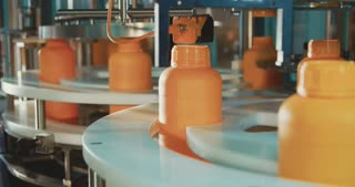 Machines in an automated chemical bottles production line