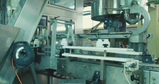Machines in chemical bottles production line