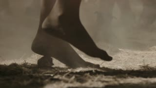 Man dancing barefooted in slow motion out in nature