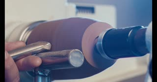 Man working on a wood lathe creating art - slow motion macro shot