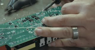 Manual soldering of components in an electronic board