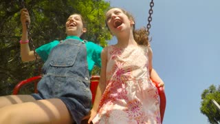 POV gopro footage of kids swinging in a playground park together