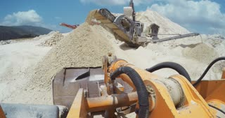 POV shot of heavy machinery at work on a large construction site
