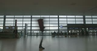 silhouette of People in airport terminal walking with luggage