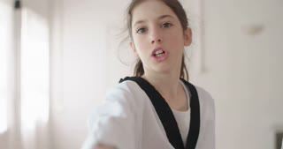 Slow motion footage of a girl practicing martial arts