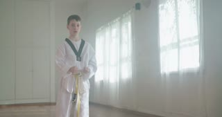 Slow motion footage of a young boy practicing martial arts