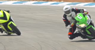 Slow motion of sport motorcycles at high speed during a race