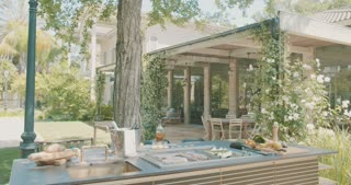 Tracking shot of a luxury outdoor kitchen in a backyard