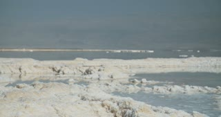 Tracking shot of salt deposits on the banks of the Dead Sea in israel