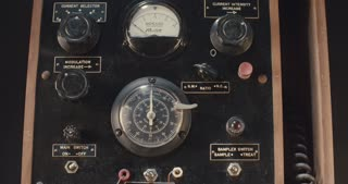 Vintage electrical switchboard with dials and switches