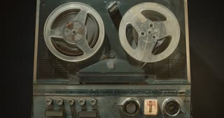 Vintage tape recorder with reels spinning