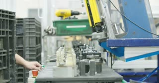 Worker in a Production line of parts for the automotive industry