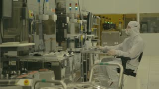 Worker in a clean suit in a Semiconductor manufacturing facility