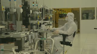 Worker in clean suit in a Semiconductor manufacturing facility