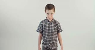 Young boy upset and mad on a white background