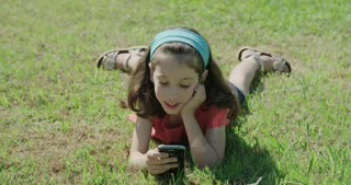 Young girl playing with a mobile phone