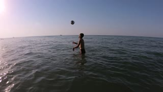 Football on the water of the sea
