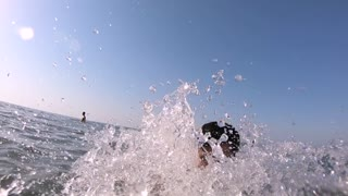 Man Under Water Then Exiting the sea