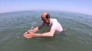 Swiming Old Man Under Water