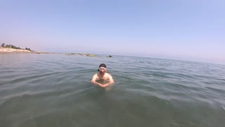 Swimming Young Man under water