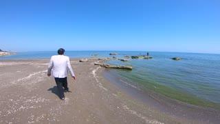 Walking Old Man Near the Sea