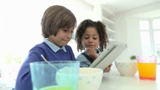 African American Children Use Digital Tablet Over Breakfast