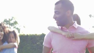 African American Parents Giving Children Piggyback Rides