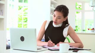 Asian Businesswoman Working From Home Using Mobile Phone