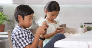 Asian Children Playing Games On Mobile Devices Shot On R3D