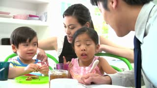 Asian Family Having Breakfast Before Father Goes To Work