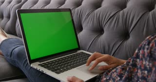 Asian Woman Using Green Screen Laptop At Home Shot On R3D