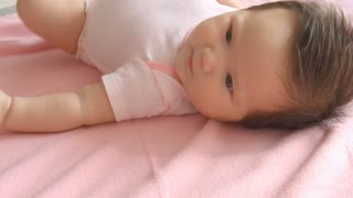 Baby Girl Laying On Pink Blanket Shot In Slow Motion