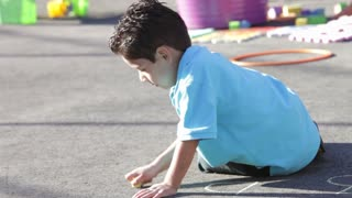 Boy Playing In Playground With Chalk
