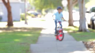 Boy Riding Bike Towards Camera