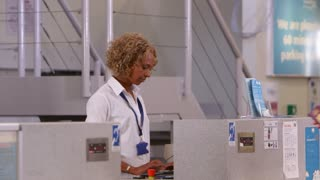 Business Couple Checking In At Airport Shot On R3D