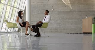 Business Meeting In Office Foyer Area Shot On R3D