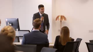 Businessman Making Presentation At Conference Shot On R3D