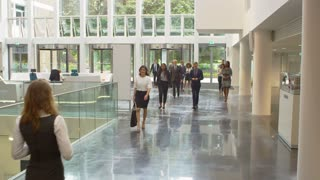 Businesspeople In Busy Lobby Area Of Modern Office Shot On R3D