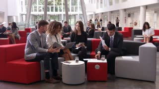 Businesspeople Meeting In Lobby Of Modern Office Shot On R3D