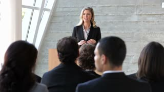Businesswoman Giving Presentation At Conference