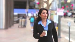 Businesswoman In Street Holding Takeaway Coffee