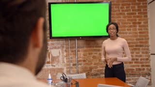 Businesswoman Standing By Screen To Deliver Presentation