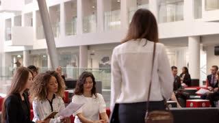 Businesswomen Meeting In Lobby Of Modern Office Shot On R3D
