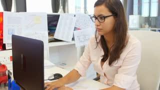 Businesswomen Working At Desks In Modern Open Plan Office