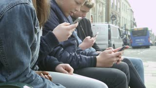 Close Up Of Teenage Friends Using Mobile Phones Shot On R3D