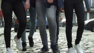 Close Up Of Teenagers Walking Along Urban Street Shot On R3D